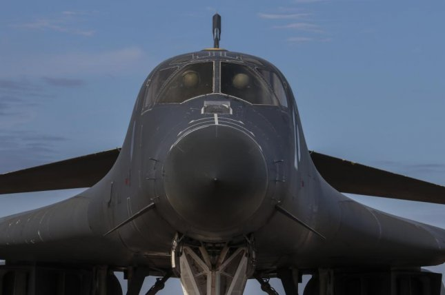 Aircrew members with the 9th Bomb Squadron conduct preflight inspections in a B-1B Lancer at Dyess Air Force Base in Texas April 19. This aircraft was flown to Tinker AFB, Okla. for structures prototyping evaluation. Photo by David Owsianka/U.S. Air Force