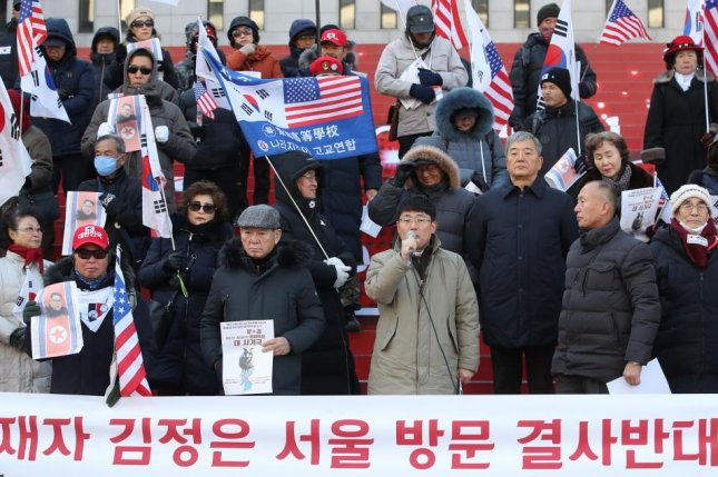 A conservative civic organization holds a news conference in downtown Seoul on Dec. 7, 2018, calling for South Korean people to rise up against North Korean leader Kim Jong-un's rumored visit to Seoul for summit talks. Photo by Yonhap