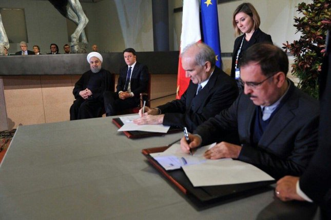Iranian President Hassan Rouhani on hand for signing of Italian business agreements, including arrangements for potential energy work. Photo courtesy of the office of the Iranian president