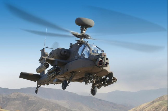 The LONGBOW FCR, mounted above the rotors of an Apache helicopter. Photo courtesy Lockheed Martin
