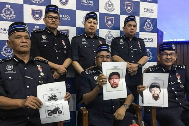 Kuala Lumpur police display sketches of two men believed to be involved in Saturday's killing of Fadi Mohammed al-Batsh, a Hamas engineer. Photo courtesy Royal Malaysia Police