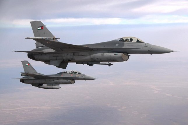Royal Jordanian Air Force F-16 Fighting Falcon aircraft fighter pilots fly alongside a U.S. Air Force KC-135 Stratotanker aircraft while waiting to connect for fuel over Jordan in 2009. Photo byCaycee Cook/U.S. Air Force