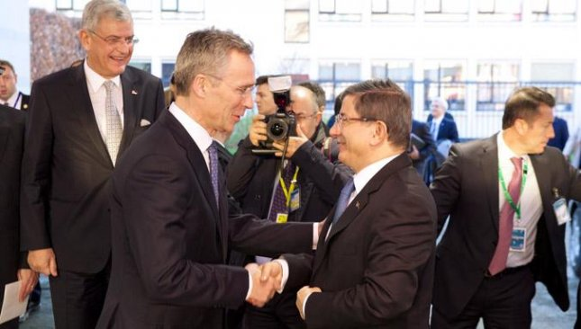 NATO Secretary General Jens Stoltenberg, left, shakes hands with Turkish Prime Minister Ahmet Davutoglu after their meeting Monday, in which Stoltenberg re-committed NATO to defending the Syrian-Turkish border. Photo courtesy of NATO.