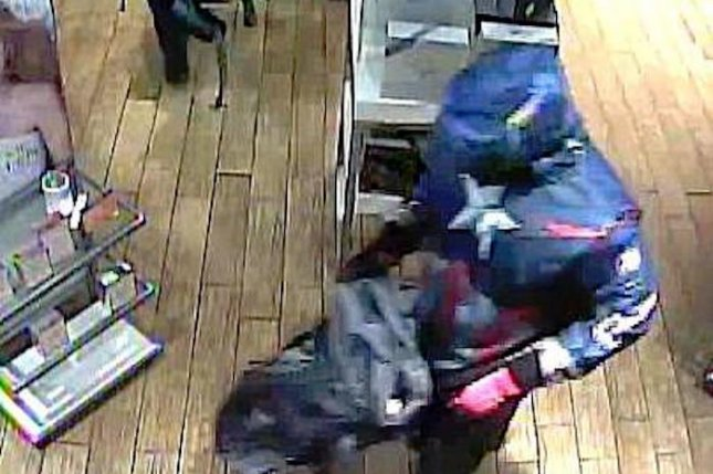 Surveillance footage shows a Texas beauty store falling victim to a superhero gone bad. Photos released by Plano Police Crime Stoppers show a man dressed as Captain America and his partner robbing an ULTA store. The two escaped in a silver SUV.  Photo by Plano Police Crime Stoppers/Facebook
