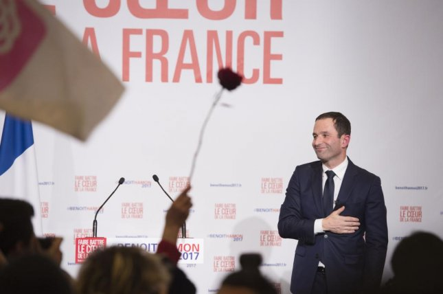 French presidential candidate and former education minister Benoit Hamon gestures on stage after winning the second round of the party primaries for the 2017 French Presidential Elections, in Paris, France, on Sunday. Poll estimates show Benoit Hamon winning the vote with 58.5 percent of the vote against Manuel Valls' 41 percent. Photo by Jeremy Lempin/EPA