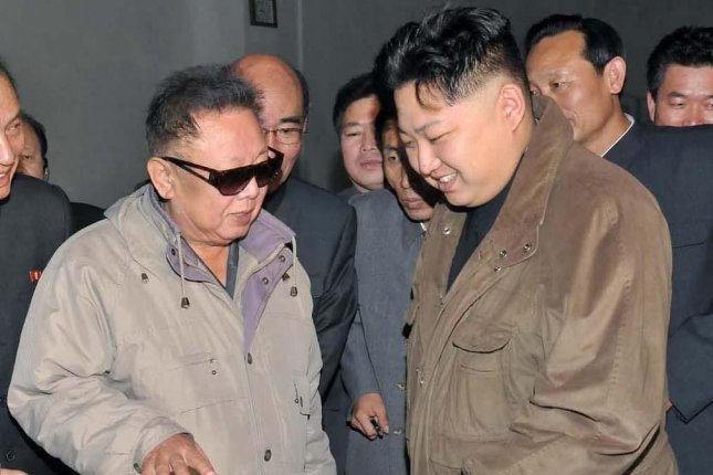 Kim Jong Il and Kim Jong Un visiting a factory prior to the late Kim's death in 2011. North Korea's commemoration of Kim Il Sung's 103rd birthday, which is Wednesday, was marked by numerous photographs of Kim Il Sung, Kim Jong Il and Kim Jong Un, but none of the three together. Photo courtesy of Yonhap.