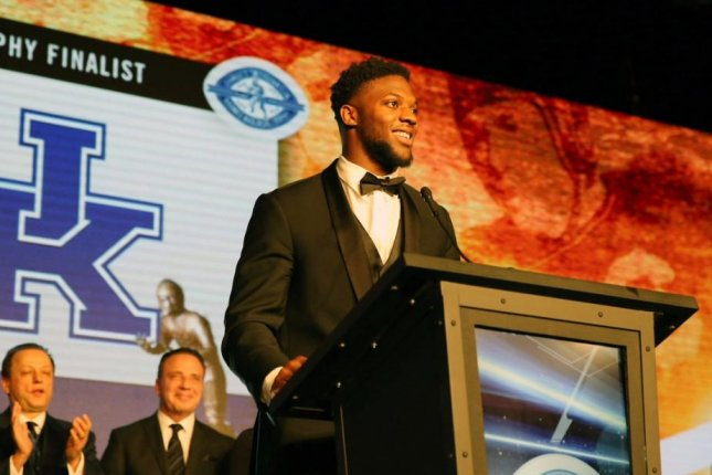 Kentucky Wildcats senior linebacker Josh Allen (C) was named the winner of the Bronko Nagurski Trophy at the Charlotte (N.C.) Touchdown Club on Monday night. Photo courtesy of Kentucky Football/Twitter