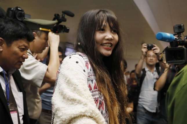 Doan Thi Huong leaves the airport after answering questions from media at Noi Bai international airport in Hanoi, Vietnam, on Friday. Photo by Luong Thai Linh/EPA-EFE