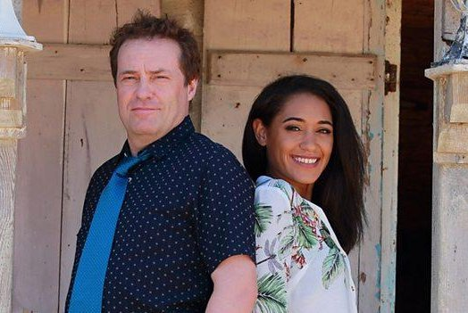 Ardal O'Hanlon and Josephine Jobert star in the crime drama Death in Paradise, which was renewed this week for an eighth season. Photo courtesy of the BBC