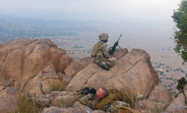 A U.S. Army soldier takes a nap -- which the Pentagon now recommends to combat sleep deprivation -- while another holds position on the Afghanistan-Pakistan border. Photo by Spc. Ken Scar/U.S. Army