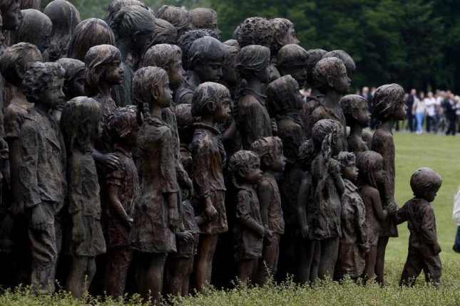 A memorial dedicated to the local children who perished in Nazi concentration camps is seen during a remembrance ceremony honoring the 70th anniversary of the destruction of the village of Lidice by the German Nazi troops, in Lidice, Czech Republic,in retaliation for the assassination of Reinhard Heydrich. File Photo by Matej Divizna/EPA