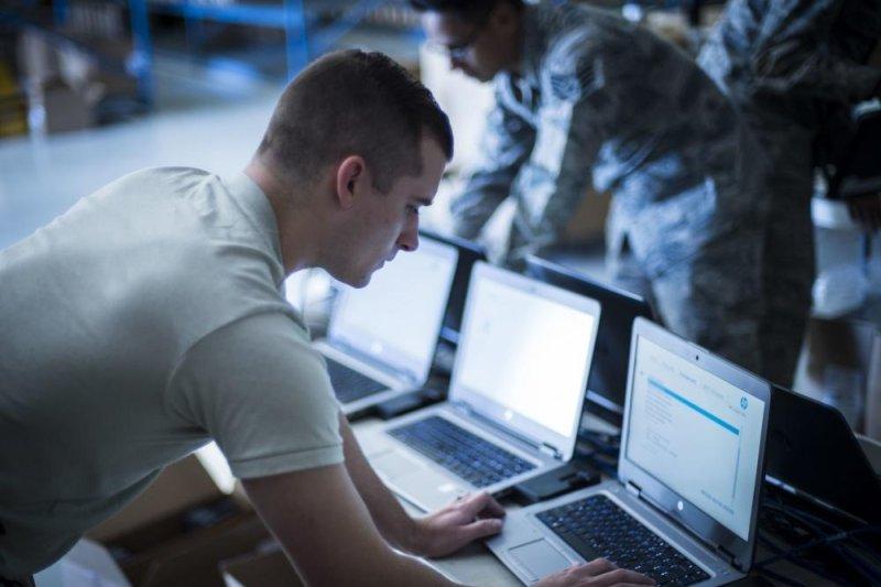 Senior Airman Zach Wilt, 49th Communications Squadron cyber operator, installs Microsoft Windows 10 to a laptop at Holloman Air Force Base, N.M., on Nov. 1, 2017. Photo by Airman 1st Class Alexis P. Docherty/U.S. Air Force
