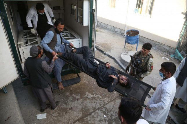 People shift body of one of the victims to a hospital after suicide bomb and gun attack, in Jalalabad, Afghanistan Wednesday morning. Photo by Hulamullah Habibi/EPA-EFE