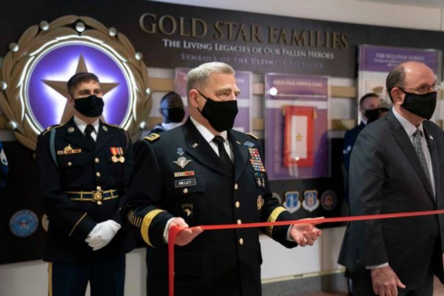 Joint Chiefs of Staff Gen. Mark A. Milley, C, unveiled a display honoring Gold Star families at the Pentagon on Thursday. Photo by PO1 Carlos Vasquez/U.S. Defense Department