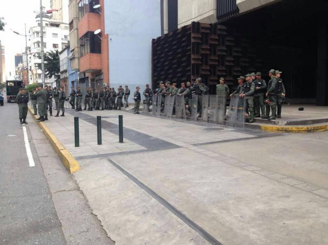Dozens of uniformed guards stood outside of Luisa Ortega Diaz's office in Caracas, Venezuela as the country's newly implemented National Constituent Assembly voted to remove her from the office of attorney general. Photo by Luisa Ortega Diaz/Twitter