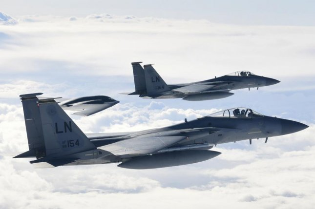 F-15C Eagles assigned to the 493rd Fighter Squadron conduct aerial operations with a B-2A Spirit in support of Bomber Task Force Europe 20-2 over the Keflavik, Iceland March 16, 2020. Bomber missions provide opportunities to train and work with NATO allies and theater partners in combined and joint operations and exercises. Photo by Matthew Plew/U.S. Air Force