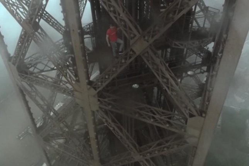 A daredevil climber scales the Eiffel Tower in Paris. Screenshot: Storyful