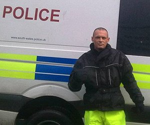 Matthew Maynard didn't approve of the mug shot they printed, so he sent them a better one... in front of a police van.