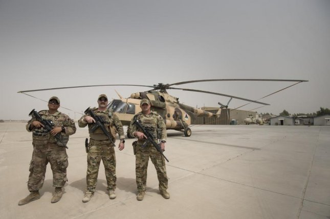 Master Sgt. Francis J. Gilson V, Master Sgt. Mark Wagner and Tech Sgt. Steven Sanchez, maintainers from Dyess Air Force Base in Texas, are deployed to Afghanistan with the Train Advise and Assist Command-Air. Photo by Staff Sgt. Ariel D. Partlow/U.S. Air Force