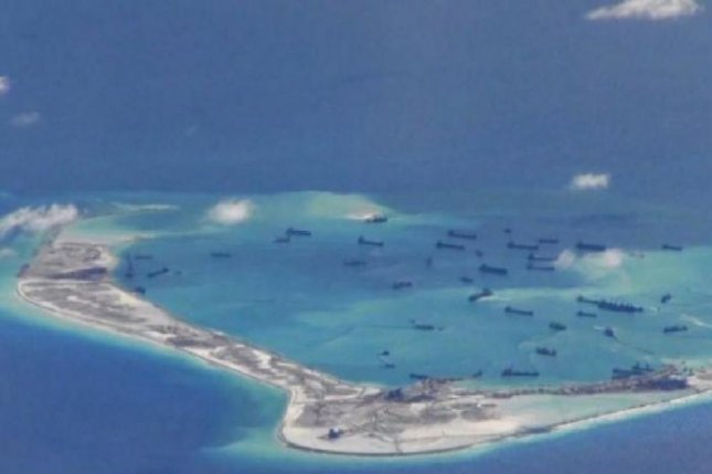 Chinese dredging vessels are seen near Mischief Reef in the disputed Spratly Islands in this May 2 photo. Washington has voiced concern over China's island-building efforts in the South China Sea and Beijing has recently broken a promise to end land reclamation. Photo courtesy of U.S. Navy