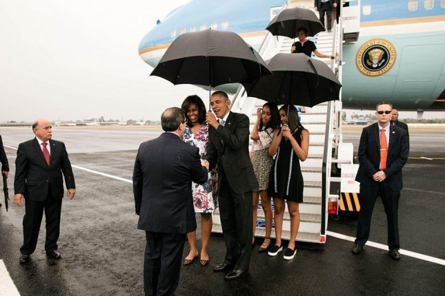 President Barack Obama, first lady Michelle Obama and their daughters Malia and Sasha greet dignitaries upon arrival in Havana on March 20. Photo by Pete Souza/The White House