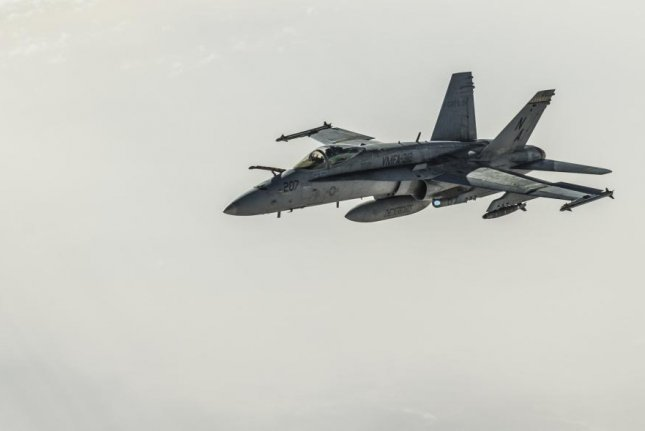 A U.S. Navy F/A-18E Super Hornet departs after receiving fuel from a KC-135 Stratotanker assigned to the 340th Expeditionary Air Refueling Squadron during a refueling mission on above Iraq March 9, 2018. Photo by Tech. Sgt. Paul Labbe/U.S. Navy