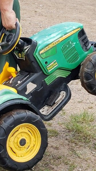 A Minnesota toddler who drove his toy tractor to a county fair Thursday without telling his parents was reunited with his family minutes later, but his driving privileges have been suspended. Photo courtesy of Chisago County Sheriff's Office
