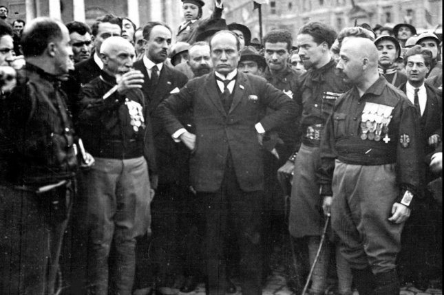 Benito Mussolini (C) appears pictured with Michele Bianchi, Emilio De Bono, Italo Balbo and Cesare Maria De Vecchi (from lft to right) during the March of Rome on October 28 1922. Mussolini, who was 38 years old at the time, assumed office on October 31, 1922 becoming the youngest Prime Minister in Italian history. File photo via Wikipedia.