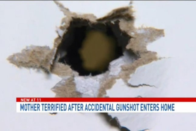 A shotgun went off while its owner was cleaning it and the blast punched holes in the walls of his Maryland neighbor's home. WJLA-TV video screenshot