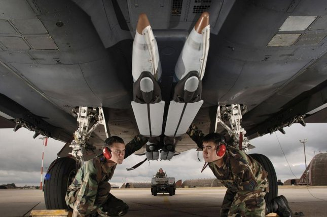 Airman 1st Class Matt Aggers (left) and Staff Sgt. Randy Broome perform a final check of the stowed twin wings on four ground-training small diameter bombs loaded on an F-15E Strike Eagle at Royal Air Force Lakenheath, England, on Aug. 1, 2006. Photo by Master Sgt. Lance Cheung/U.S. Air Force