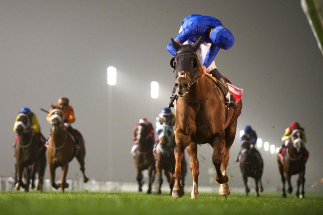 James Doyle looks around for competition and finds none as Hunter's Light easily wins the Jebel Hatta on Super Saturday at Meydan. (DRC photo/Andrew Watkins)