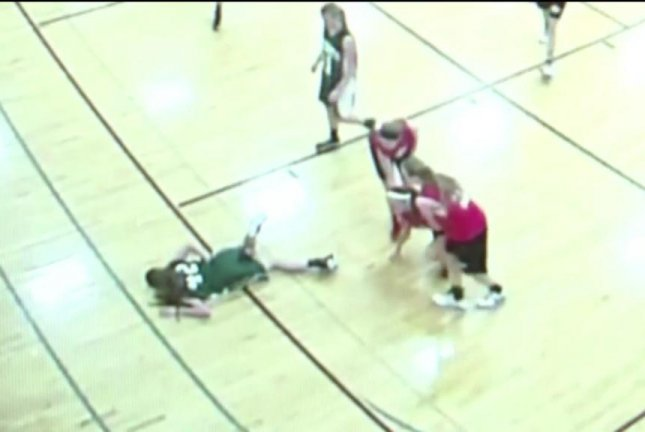 A 14-year-old basketball player in Wisconsin is impaled on a broken floorboard. Screenshot: KTRK-TV