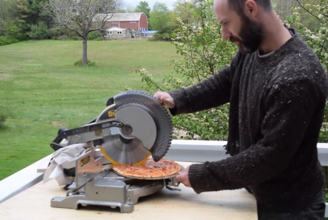Woodworkers get creative cutting pizza into slices with electric chop saw