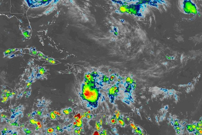 Tropical Storm Isaac was expected to weaken to a tropical depression before passing near or over Jamaica on Sunday, but the National Hurricane Center said that prediction was uncertain. Image courtesy of NOAA