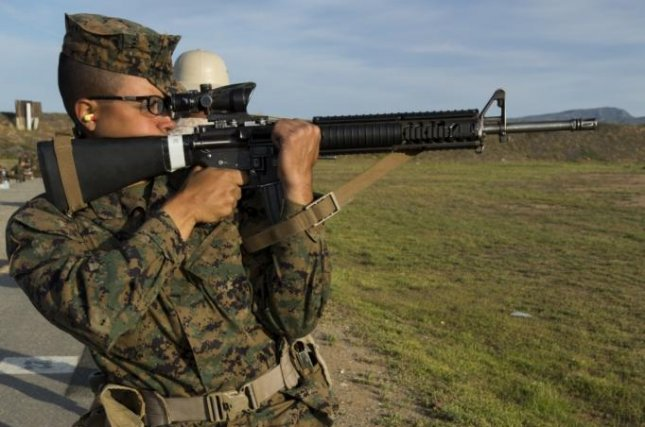 A U.S. Marine Corps recruit looks through the rifle combat optic of an M16A4 service rifle in this 2016 photo. FN America and Colt's Manufacturing received a $383.3 million contract to manufacture the rifles for several governments. Photo by Erick J. ClarosVillalta/U.S. Marine Corps