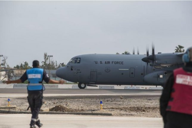 Israeli service members guide a C-130J Hercules after it lands at Hatzor Air Force Base, Israel, during Juniper Falcon 21-1 in February. Photo by PO2 Cody Hendrix/U.S. Air Force