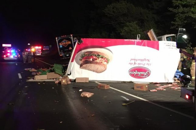 The aftermath of a crash between a deli meat truck and a bread truck on a New Jersey highway. Photo by the New Jersey State Police/Facebook