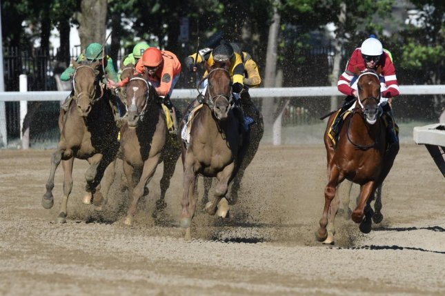 Gun Runner (right, purple silks) starts to edge away from his pursuers en route to victory in the Grade I Whitney on August 5, 2017 at Saratoga. Photo courtesy of NYRA