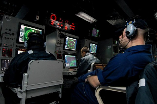 Naval crew members man the AN/SQQ-89V15 Surface Anti Submarine Combat System aboard the guided missile destroyer USS Momsen. Photo by Petty Officer 2nd Class James R. Evans/U.S. Navy