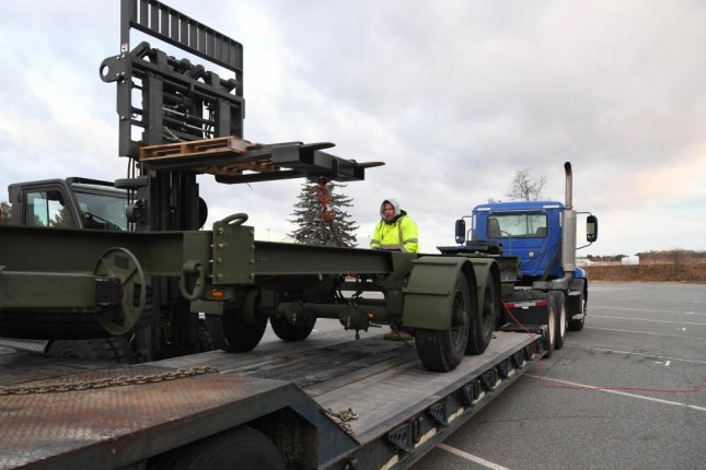 66th Logistics Readiness Squadron employees coordinate the unloading of a testing trailer in January 2019 at Hanscom Air Force Base to test loading and delivery of parts of the 3DELRR. Photo by Linda LaBonte Britt/U.S. Air Force
