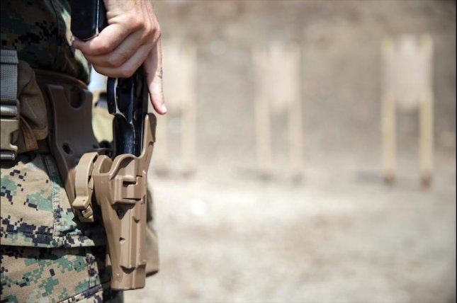 The Sig Sauer contract signals the end of the Beretta M9's service. It has been the standard sidearm for the U.S. Armed Forces since 1985. Pictured, a U.S. Marine holsters a Beretta M9 handgun. U.S. Marine Corps photo by Cpl. Alexander Mitchell
