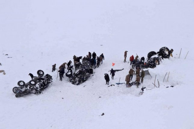 Soldiers, rescue workers and other emergency personnel gather in Bahcesaray district in eastern Turkey on Wednesday. Photo by DHA Agency/EPA-EFE