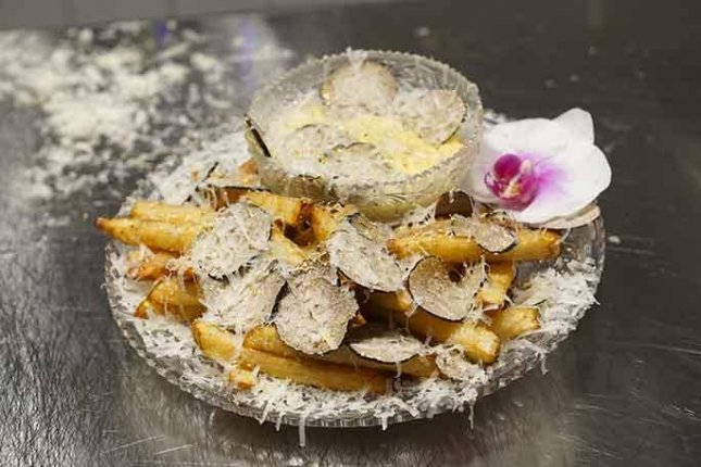 New York restaurant Serendipity3 earned its 10th Guinness World Record with a $200 plate of French fries dubbed the world's most expensive. Photo courtesy of Guinness World Records