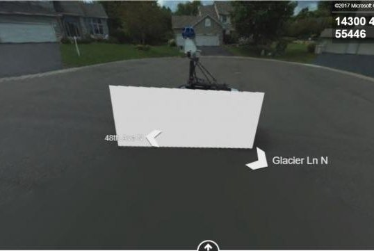 Google and Bing's camera cars passed each other on a Minnesota road in 2014 and the image that ended up on Bing's Streetside map feature ended up censoring the Google car with a white block. Screenshot: Bing Maps