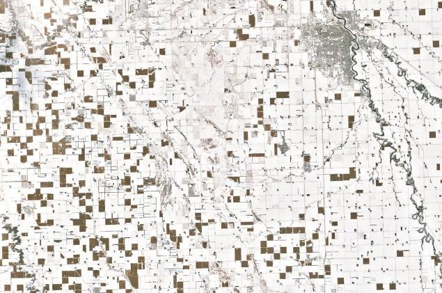 Snow and unharvested cornfields have combined to create a checkerboard pattern across North Dakota. Photo by Landsat 7/NASA