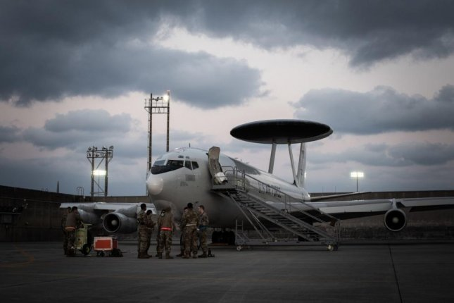 U.S. Airmen of the 18th Maintenance Group prepare an E-3 Sentry aircraft before participating in exercise Westpac Rumrunner, out of Kadena Air Base, Japan, Jan. 10. Boeing has received a $99.9 million upgrade to the E-3 Sentry Airborne Warning and Control System. Photo by Daniel E. Fernandez/U.S. Air Force
