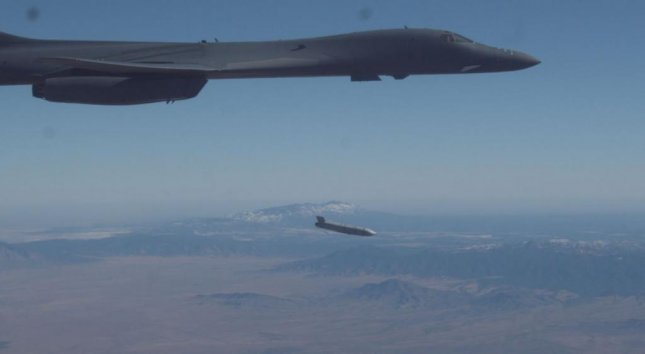 A B-1B Lancer releases a Joint Air-to-Surface Standoff Missile during an external release demonstration over Holloman Air Force Base, N.M., on Dec. 4. Photo by Ethan Wagner/U.S. Air Force