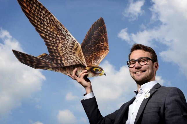 Nico Nijenhuis, CEO of Clear Flight Solutions, holds his company's invention, a robotic falcon designed to scare birds away from airports and other industrial sites. Photo courtesy University of Twente