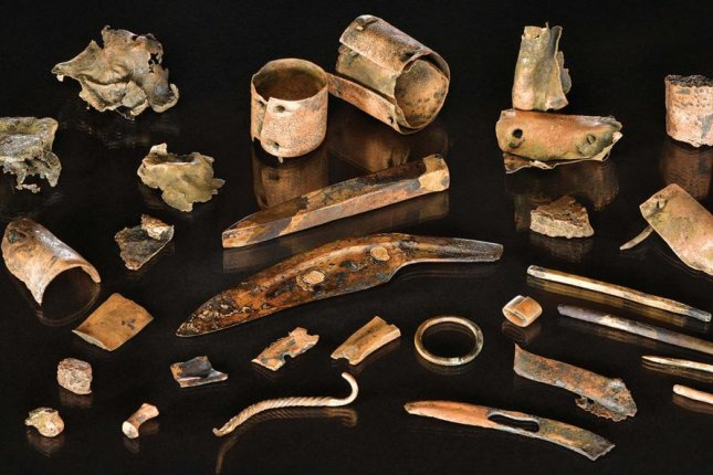Researchers recovered dozens of personal objects, including decorative pins and metal knives, belonging to a Bronze Age warrior killed on a battlefield in Germany. Photo by V. Minkus/Antiquity