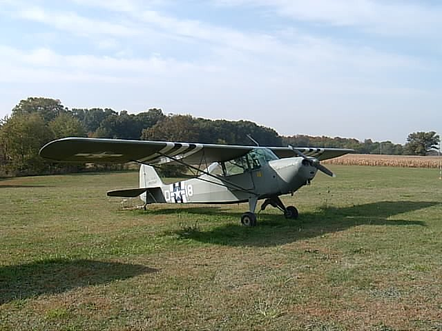 A Taylorcraft L-2M, one of the many variants of Taylorcraft WWII-era planes courtesy of RBaldwi3 via Wikimedia Commons.